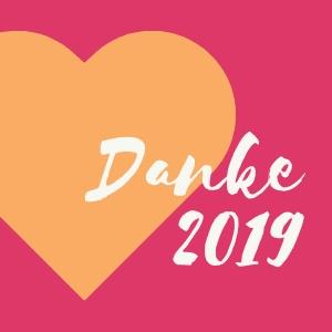 Orangenes Herz vor pinkem Hintergrund mit Text Danke 2019